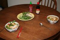 vegetarian pho for two, with garnishes and condiments
