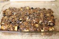 Tofu-stuffed eggplant with mushroom ragout in baking dish