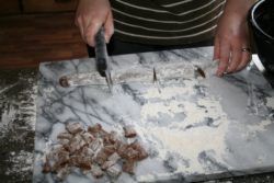 Cutting up peppernuts with a dough cutter