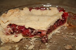 Slice of cherry rhubarb pie